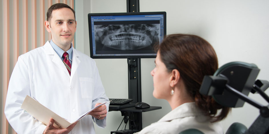 Photo of Patient Asking Questions to Oral Surgeon